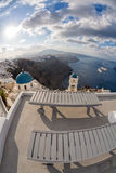 Town of Thira on the island Santorini, famous church against sunrise  in Greece Royalty Free Stock Photography