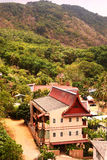 town with tiled roofs and part of palm jungle Royalty Free Stock Photo