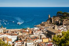 The town of Tossa de Mar and view on the sea and harbor. Beautiful city in Catalonia with historic old town, Spain. stock photos