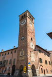 Town Tower in Cherasco, Italy. Cherasco,Italy,Europe - May 3, 2016 : The Town Tower and the Town Hall in via Cavour Royalty Free Stock Image