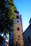 Town tower of Ptuj behind tree stock photo