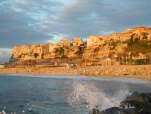 Panorama of an italian town at the mediterranean sea in the evening sun Stock Photography