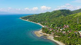 Town on a tropical island. Seascape, Philippines, aerial view. stock video footage