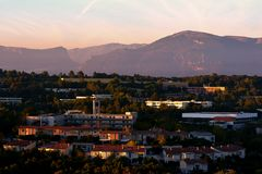 Town at twilight in mountain valley Stock Photos