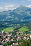 Town in Tyrol. Austria, with mountains behind Royalty Free Stock Image