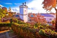 Town of Udine landmarks view with red sun haze Royalty Free Stock Images