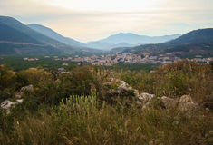 Town in a valley. Between high mountains Stock Photos