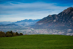 A town in the valley surrounded by mountains. Looking down into the valley and seeing the town from up high Royalty Free Stock Photo