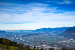 A town in the valley surrounded by mountains. This was shot in Switzerland during the summer Royalty Free Stock Photos