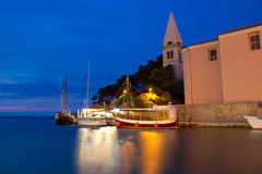 Town of Veli Losinj church and harbour. At blue hour, Croatia Royalty Free Stock Images