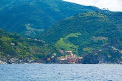 The town of Vernazza, one of the five small towns in the Cinque Terre national Park, Italy. View from the excursion ship. Amazing colorful small town located royalty free stock photos
