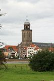 Town-view with church; Deventer. Sight of the dutch town Deventer and the large Lebuinus Church. Deventer is situated along the river IJssel Royalty Free Stock Photo