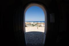 Town view through the door way. Town view on the seashore through the round door way Stock Image