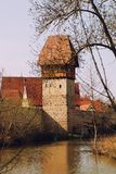 Town wall and tower of historic city dinkelsbuhl. Town wall and old tower of historic city dinkelsbuhl, middle franconia, moat with water Stock Image