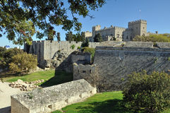 The town walls and moat in Rhodes. The dry moat and massive walls circle the ancient greek city of rhodes for a distance of over 2 miles, the prominent building royalty free stock image