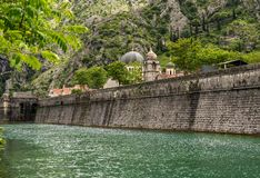 Town walls surround the Old Town of Kotor in Montenegro stock photo