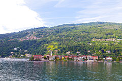 A town waterfront and suburban landscape on the Lake Maggiore in Northern Italy. Royalty Free Stock Images