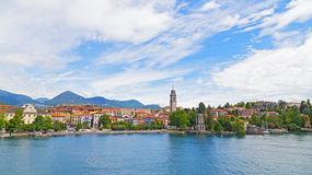 A town waterfront and suburban landscape on the Lake Maggiore in Northern Italy. Stock Photo