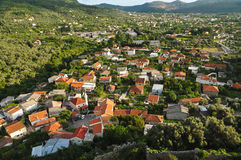 Town in a wooded valley. Montenegro. Red roofs of houses in the wooded valley stock photo
