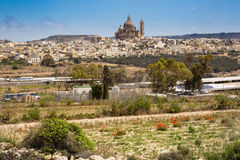The town Xewkia on the Maltese islands Gozzo. View of the town Xewkia on the Maltese islands Gozzo in the Mediterranean sea Stock Photos