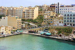 Town of Xlendi. Apartments in the seaside resort of Xlendi on the island of Gozo in Malta Stock Photo