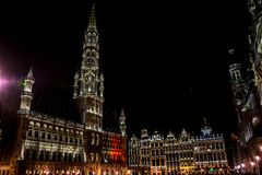 The townhall and belfry tower of Brussels is illuminated and lit. Up at night, Belgium, Europe Stock Photos