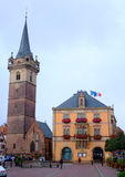 Townhall and clock tower of Obernai city - Alsace Stock Photo