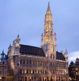 Townhall in Grand Place, Brussels. At dusk Stock Photos