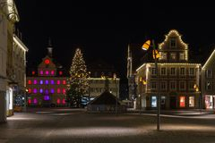 Townhall and marketplace at advent christmas time evening. In a historical city of south germany december near city of munich and stuttgart royalty free stock photo