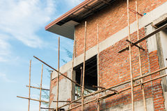 Townhome & Construction Site in progress to new house. Blue sky and townhome & Construction Site in progress to new house in Thailand Royalty Free Stock Photos