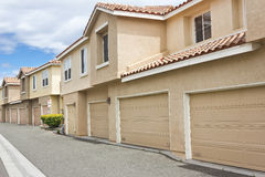 Townhome Garages. Garages face the alley way for these modern townhomes Royalty Free Stock Image