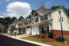 Townhomes or condominiums. A row of new townhomes or condominiums royalty free stock photography
