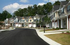 Townhomes or condominiums. A row of new townhomes or condominiums stock image