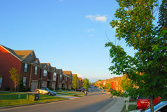 Townhomes in suburbia. Townhomes in a long row extending into the distance Royalty Free Stock Image