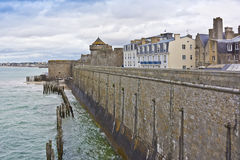 Townhouse and defensive walls in Saint-Malo. Royalty Free Stock Images