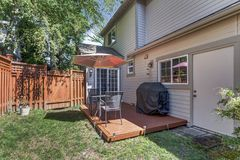 View of a small backyard with wooden deck Stock Photography