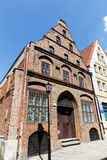 Townhouse of merchants in Kolobrzeg. KOLOBRZEG, POLAND - JUNE 23, 2016: Made of brick Townhouse of Merchants was built early of the 15th century and after war Royalty Free Stock Images
