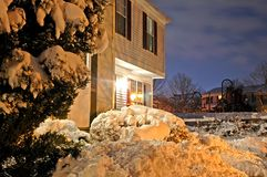 Townhouse After Snowstorm. My front door at night, after shoveling the walkway following a large snowstorm Royalty Free Stock Images