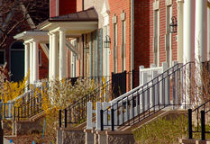 Townhouse steps and doorways. Steps or stairs leading to urban townhouse or condos with small porches Royalty Free Stock Image