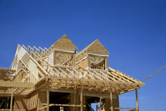 Townhouse Under Construction. A townhouse under construction showing the framing for the roof and gables. It is the beginning of a new development at Wasaga Royalty Free Stock Image