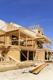 Townhouse Under Construction. This shows a townhouse under construction at Wasaga Beach, Ontario, Canada. The framing is almost complete and they starting to put Royalty Free Stock Photo