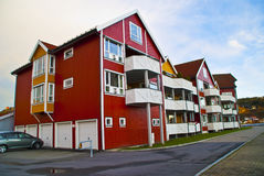 Townhouses. Beautiful townhouses built in wood at the harbor in Halden. The houses have balconies with view to the sea and the river Stock Photos