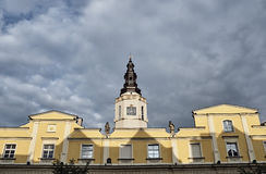 Townhouses And Town Hall Tower With Clock Stock Photography