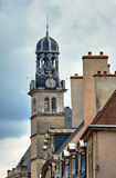 Townhouses and belfry with a clock Royalty Free Stock Photos