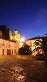 Townhouses and bell tower, Antequera, Spain. Castle bell tower (torre del homenaje) and townhouses in the Plaza de Santa Maria at dusk, Antequera, Malaga Stock Photos
