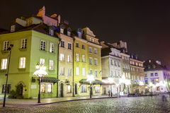 Townhouses at the Castle Square at night, Warsaw Stock Images
