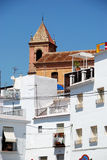 Townhouses and church, Torrox. Stock Photo