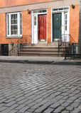Townhouses on cobblestone street. In Greenwich Village, NYC Royalty Free Stock Image