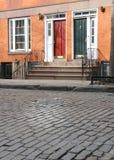 Townhouses on cobblestone street royalty free stock image