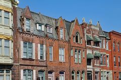 Townhouses with gables and brownstone trim. Row of old townhouses with gables and brownstone trim stock photos